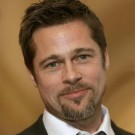 Actor Brad Pitt appears with House Speaker Nancy Pelosi before their meeting in Washington